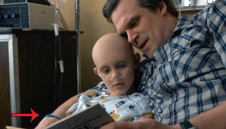 wearing his daughter's blue ribbon